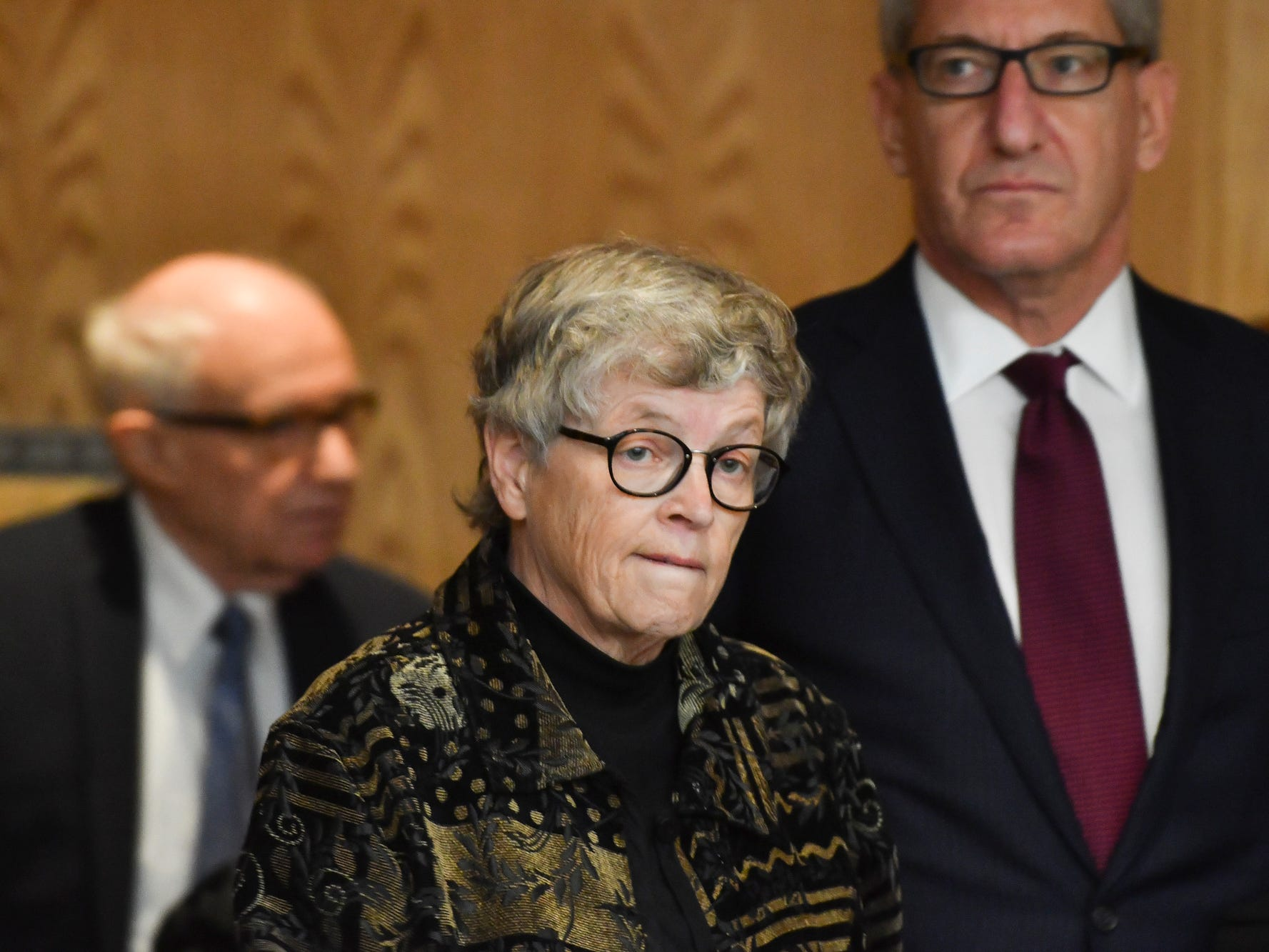Flanked by her attorneys Mayer Morganroth, left, and Lee Silver, former MSU President Lou Anna Simon appears before Judge Julie Reincke in Eaton County on Monday, Nov. 26, 2018, for her arraignment on four charges of lying to police related to the Larry Nassar investigation.  [AP Photo/Matthew Dae Smith/Lansing State Journal]