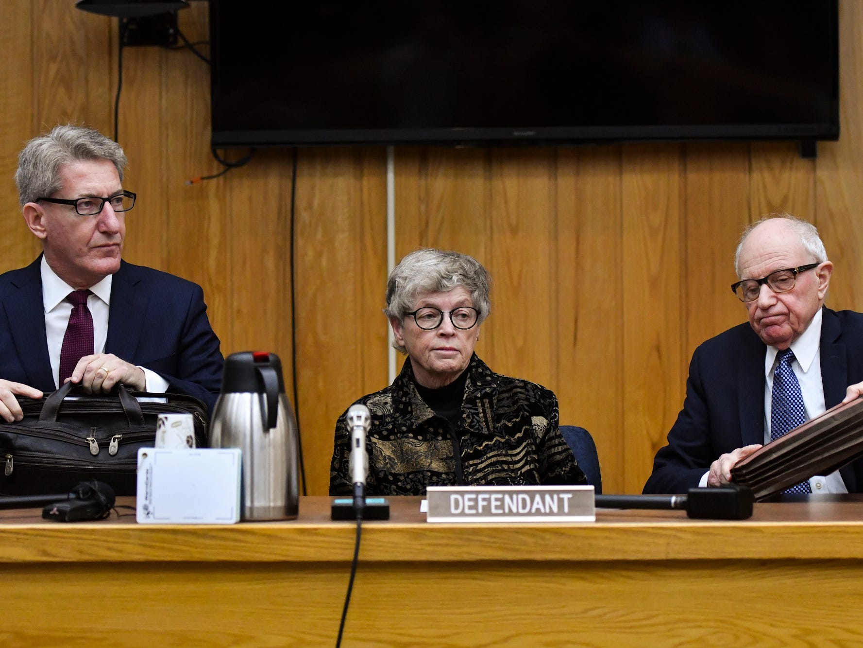 Flanked by her attorneys Lee Silver, left, and Meyer Morganroth, former MSU President Lou Anna Simon appears in Judge Julie Reincke's Eaton County Court Monday, Nov. 26, 2018, for her arraignment on four charges of lying to police related to the Larry Nassar investigation.  [AP Photo/Matthew Dae Smith/Lansing State Journal]rr