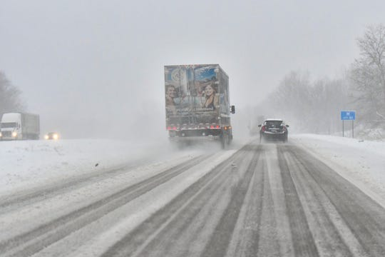 Traffic moves slowly down I-69 south Monday morning, Nov. 26, 2018.  The Lansing area received its first significant snowfall overnight.