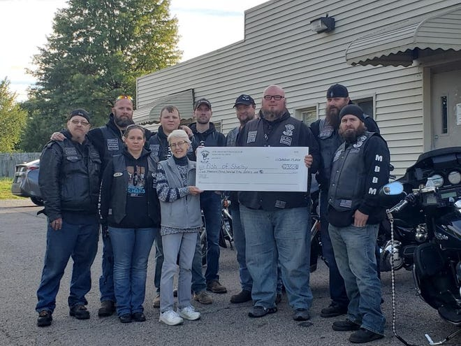 Members of the Shelby Chapter of the Iron Order International Motorcycle Club, called the Heavy Metal Crew, recently donated $2,350 to the Fish of Shelby food pantry.