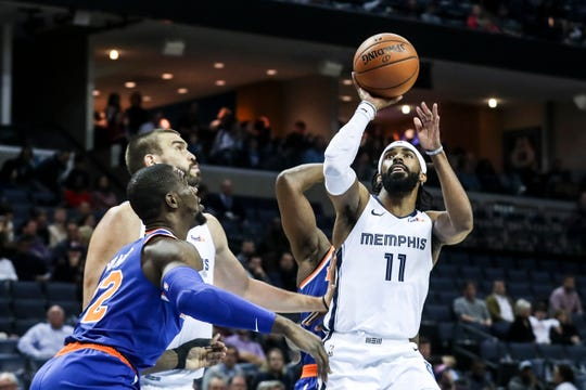 November 25 2018 - Mike Conley attempts a shot during Sunday night's game versus the New York Knicks at the FedExForum.