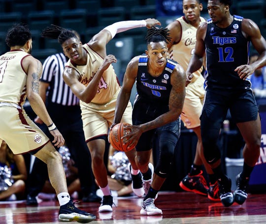 Memphis forward Kyvon Davenport (middle) grabs a rebound in of the College of Charleston offense during third day action in the Advocate Invitational in Orlando Sunday, November 25, 2018.