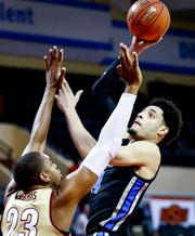 Memphis forward Isaiah Maurice (right) makes a basket in front of College of Charleston defender Nick Harris (left) during third day action in the Advocate Invitational in Orlando Sunday, November 25, 2018.