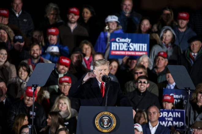 President Donald Trump speaks during a rally for Sen. Cindy Hyde-Smith at the Tupelo Regional Airport on Monday in Tupelo, Mississippi. Hyde-Smith faces Democratic challenger Mike Espy in a runoff for the Senate seat on Tuesday.