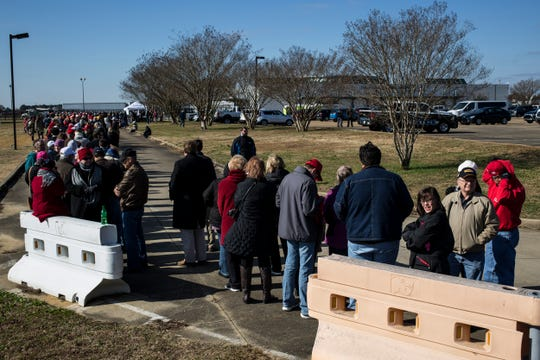 November 26 2018 - People line up early before a rally where President Donald Trump will speak in support of Sen. Cindy Hyde-Smith at the Tupelo Regional Airport on Monday. Hyde-Smith faces Democratic challenger Mike Espy in a runoff for the Senate seat on Tuesday.