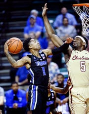 Memphis guard Tyler Harris (left) is called for a foul as he crashes into College of Charleston defender Jarrell Brantley (right) during third day action in the Advocate Invitational in Orlando Sunday, November 25, 2018.