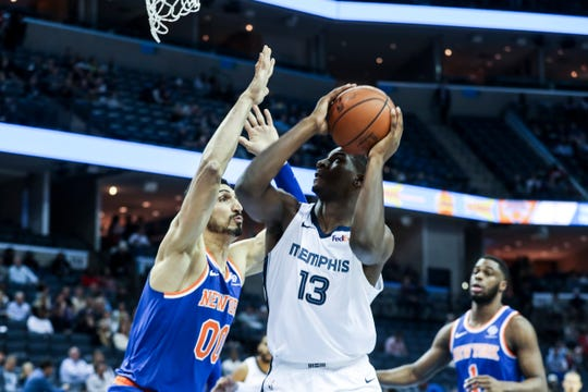 November 25 2018 - Jaren Jackson Jr. goes up for a shot against Enes Kanter during Sunday night's game versus the New York Knicks at the FedExForum.