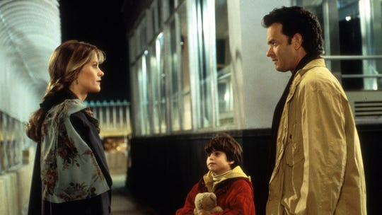 "Meg Ryan, young Ross Malinger and Tom Hanks star in ""Sleepless in Seattle."""