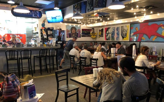 Tons of artwork by local artists adorn the walls at LowBrow Pizza and Beer in East Naples.
