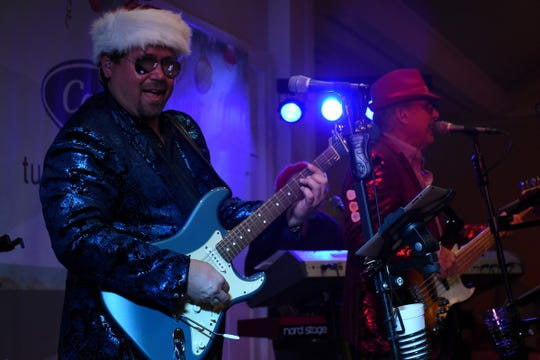 Ryan Darling and Tripleshot provided rousing holiday music for Saturday's Jingle Bell Bash.