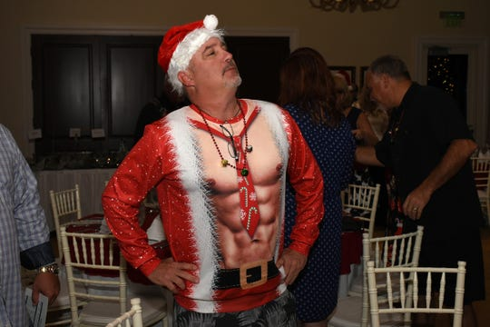 Santa never looked so good as evidenced here by Jim Gratkowski in a revealing Santa costume.