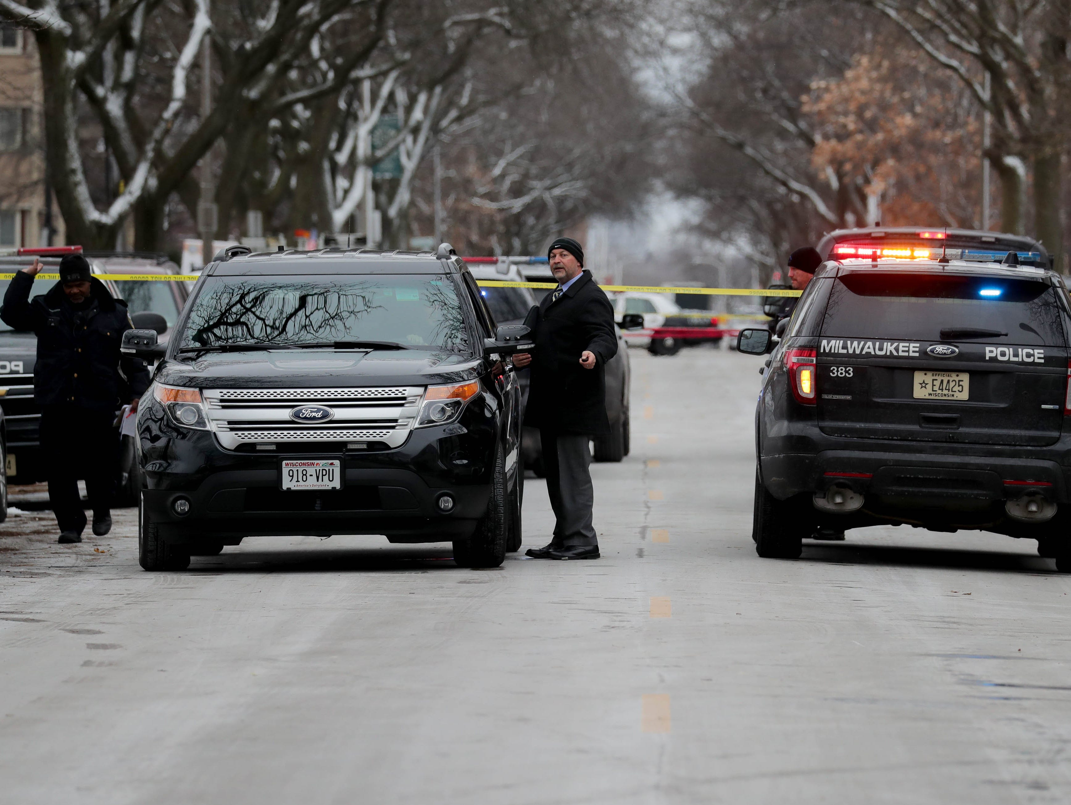 Milwaukee police investigate the scene of what is believed to be an officer-involved shooting in the 2800 block of West Wells Street Monday.