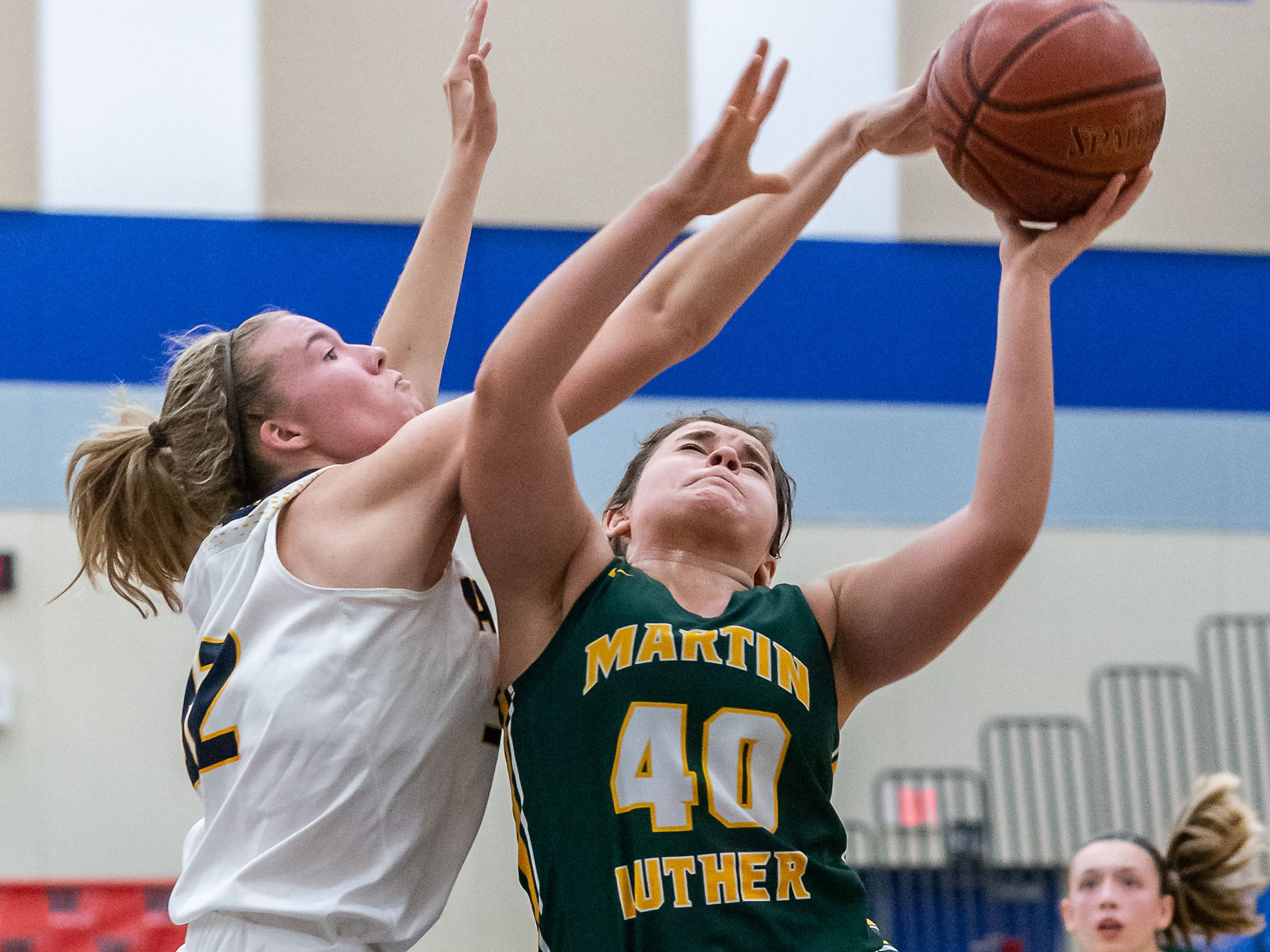 Martin Luther sophomore Abby Hafemann (40) battles for a shot against Kettle Moraine's Madeline Siedenburg during the Brookfield Central Thanksgiving Shootout on Saturday, Nov. 24, 2018.
