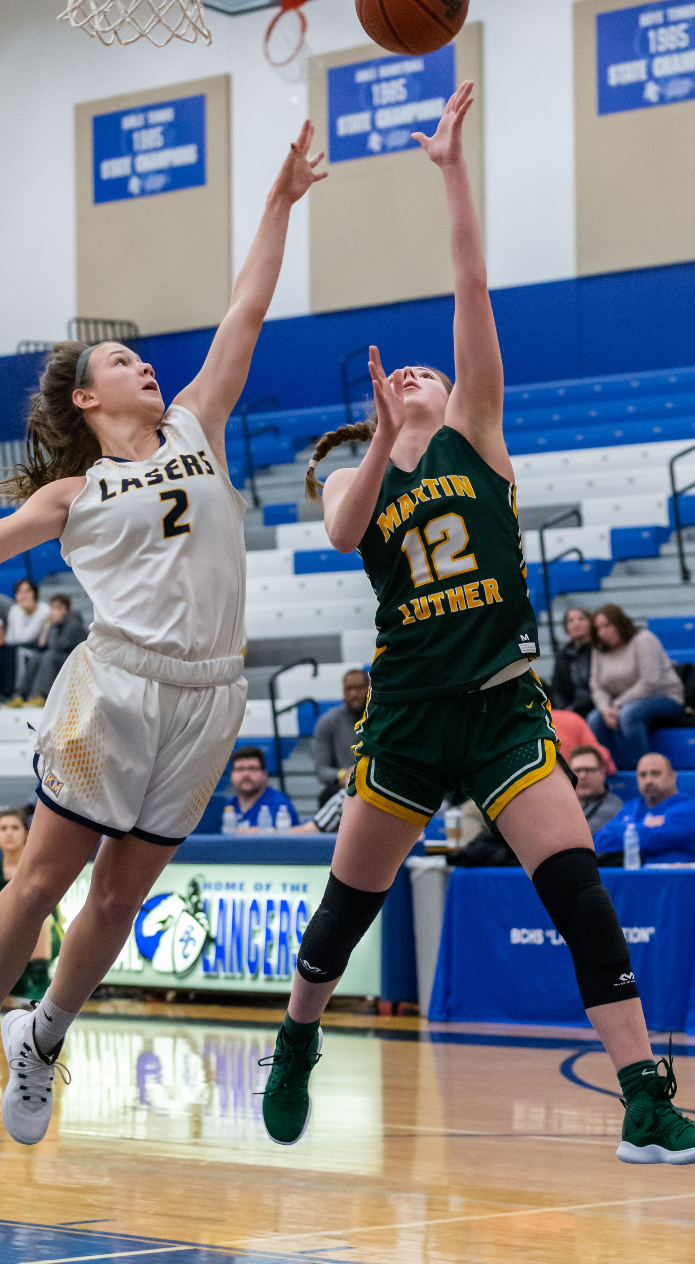 Martin Luther senior Emma Kallas gets a shot past Kettle Moraine's Mia Haertle  during the Brookfield Central Thanksgiving Shootout.