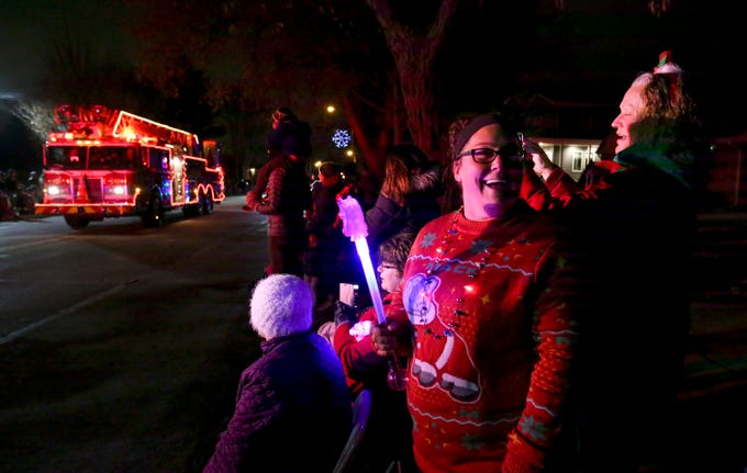Allison Young and Chris Henley (right) watch the first South Milwaukee Lions Club Lighted Christmas Parade roll along 15th Avenue near City Hall on Nov. 24 that followed the Old Fashioned Christmas festivities at City Hall.