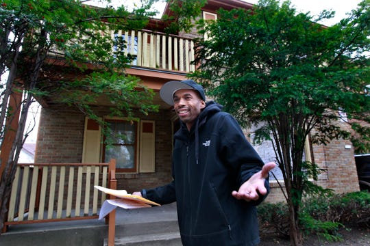 John Wesley Jr. stands in front of his late father's home in Milwaukee. Shortly after his death, John W. Hemphill tried to seize the house, claiming the home was being placed in receivership because the house was abandoned and had building code violations.