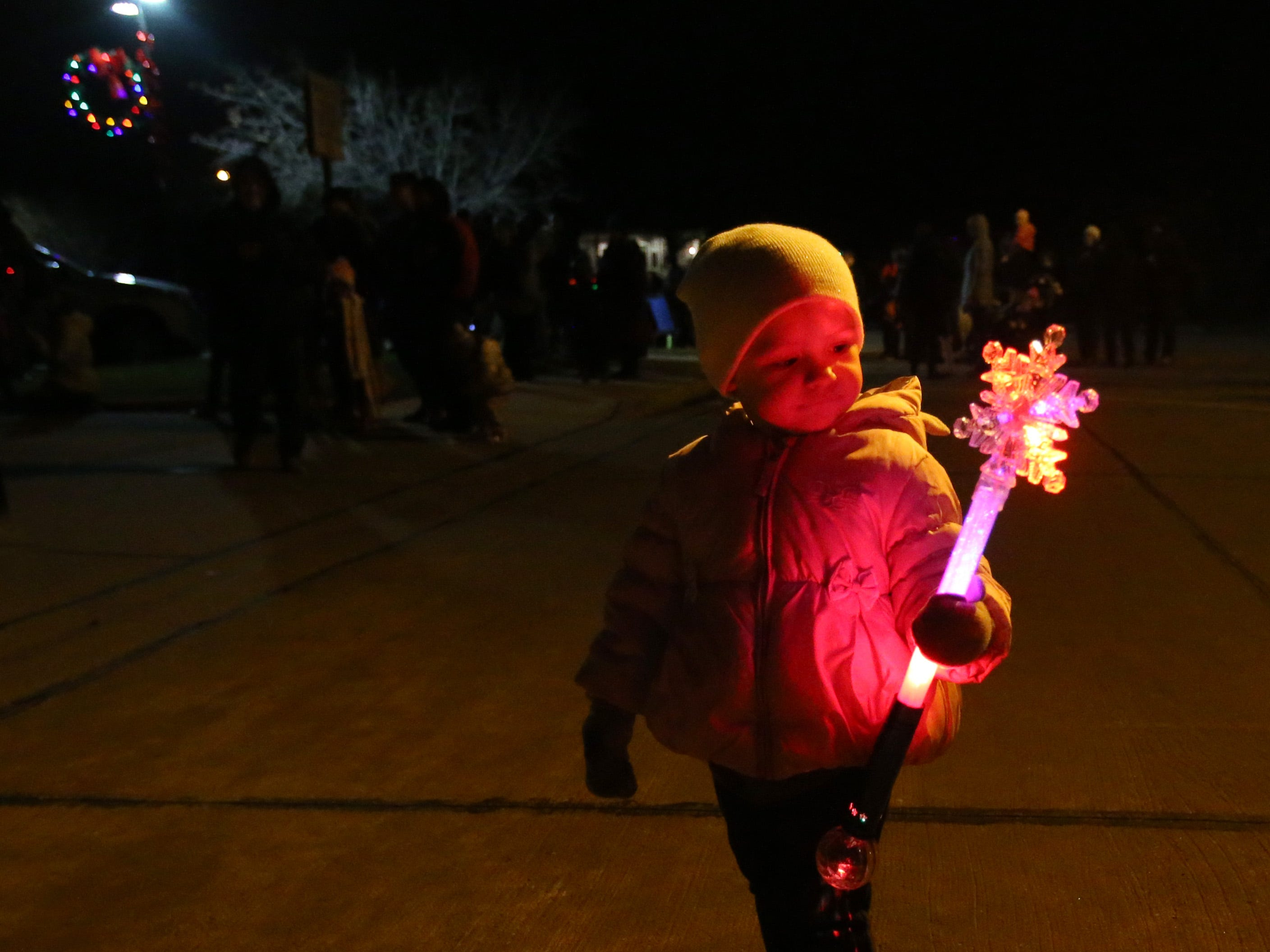 Nora Hintz plays with a lit wand while waiting for the start of the first South Milwaukee Lions Club Lighted Christmas Parade along 15th Avenue near City Hall on Nov. 24 that followed the Old Fashioned Christmas festivities at City Hall.