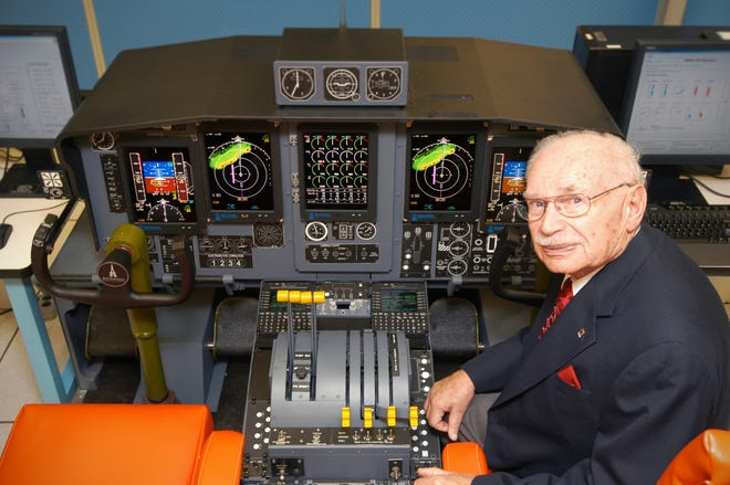 Nate Zelazo, founder of Astronautics Corporation of America, was a pioneer in avionics. Here he's shown in an aircraft flight simulator.
