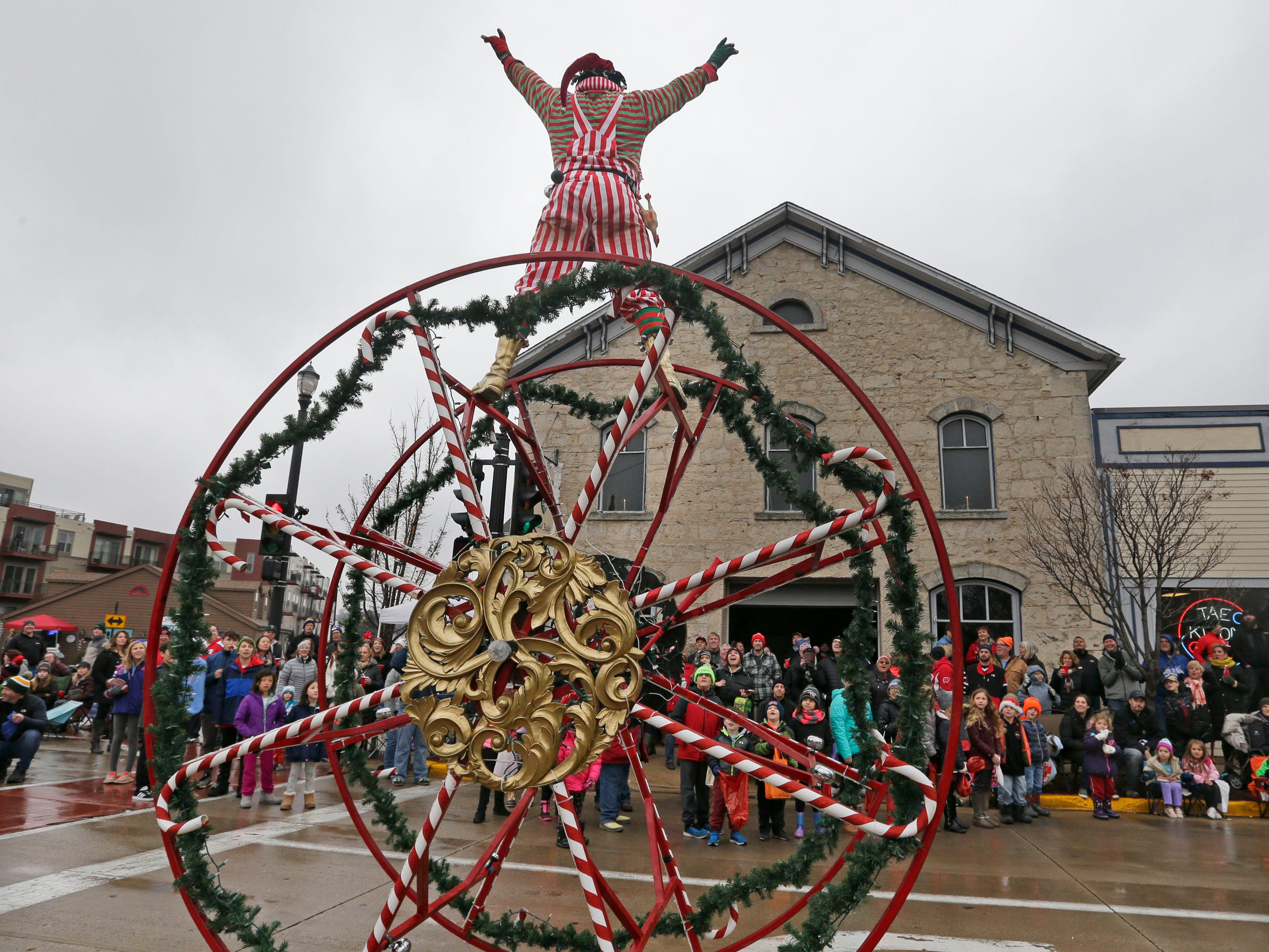 Rob Summerbell stands atop the wheel to cheers from the crowd.