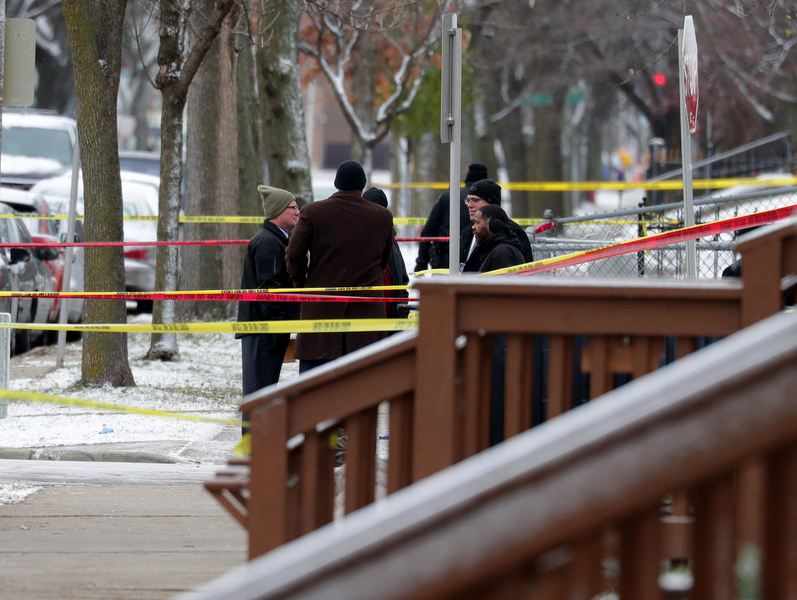 Milwaukee police investigators work at the scene of what is believed to be an officer-involved shooting in the 2800 block of West Wells Street Monday.