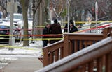 Milwaukee police investigate the scene of an officer-involved shooting in the 2800 block of West Wells Street.