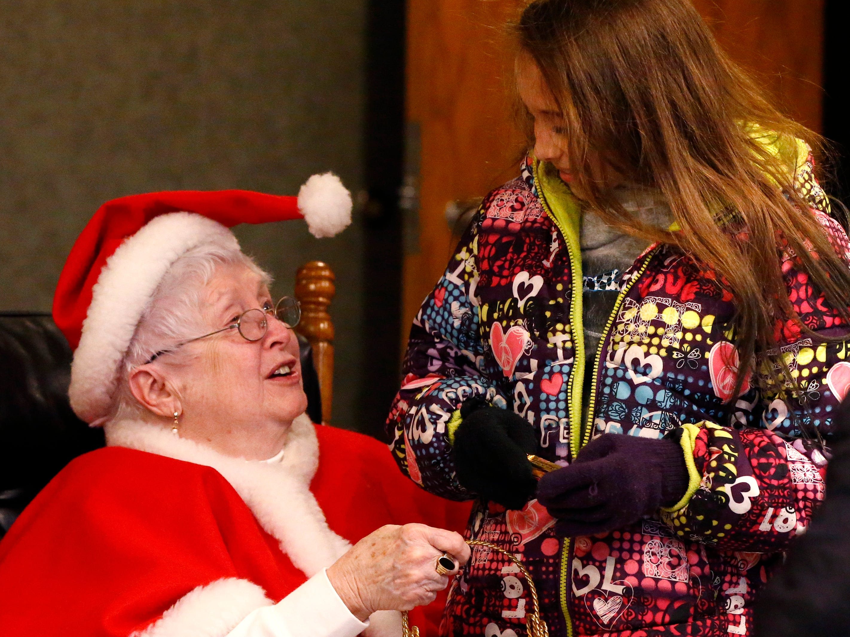 Ariana Schroeder, 12, talks with Mrs. Claus during South Milwaukee's Old Fashioned Christmas at City Hall on Nov. 24. A tree lighting and the first Lit Christmas Parade followed the gathering.