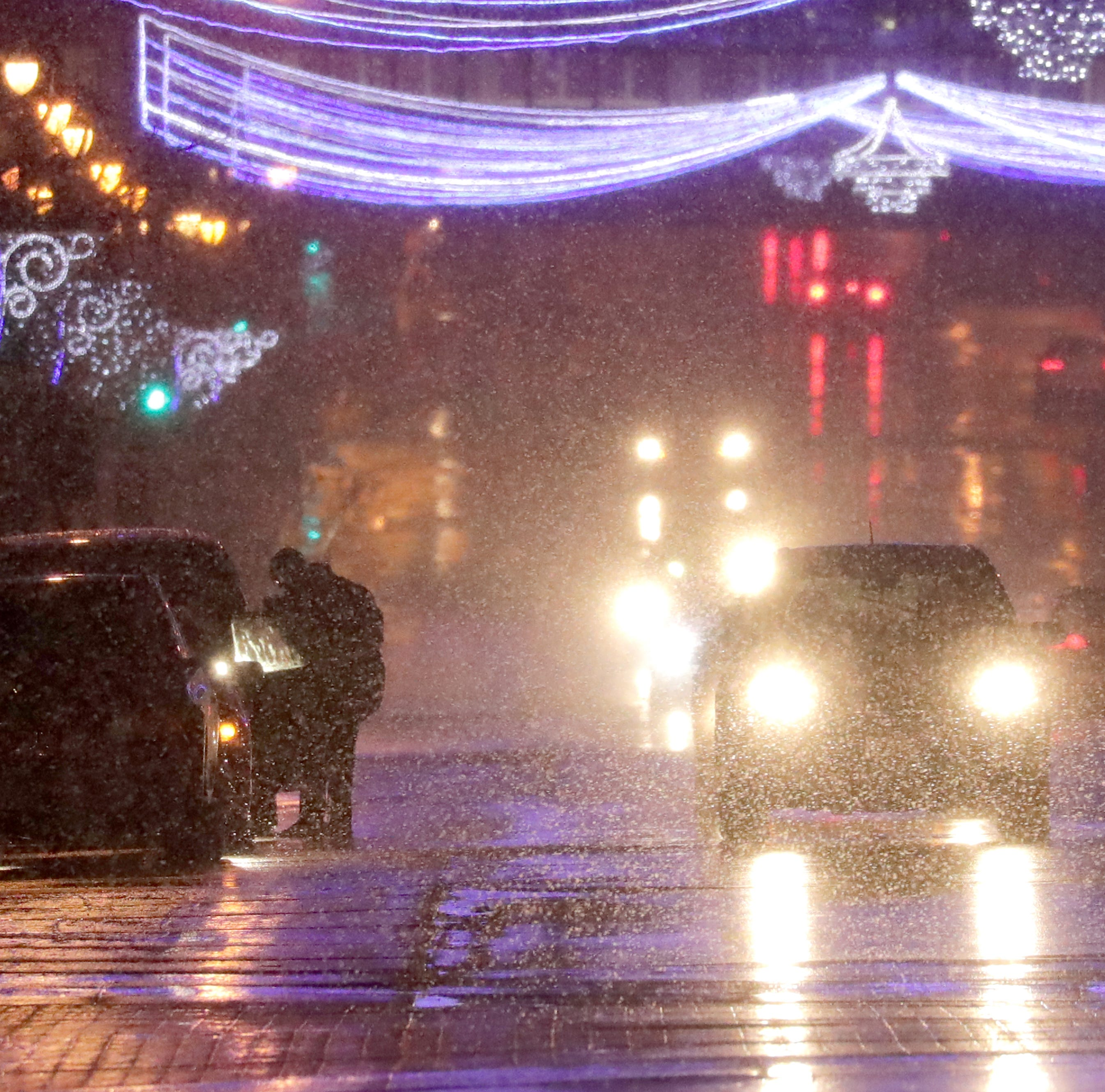 Snow showers Sunday night could linger into Monday morning, making roads slippery for commuters
