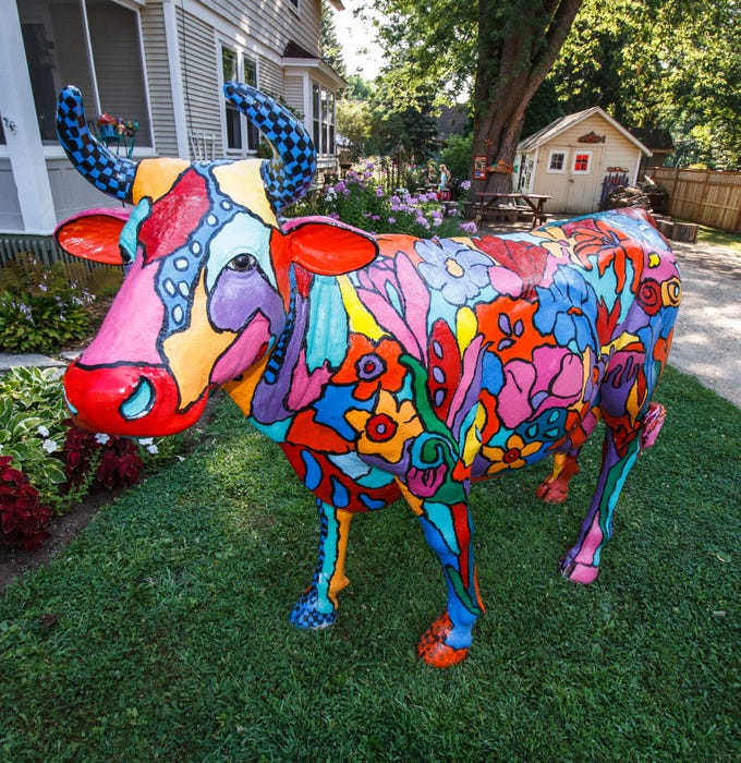 Pewaukee artist Ramona Audley displayed this colorful life-sized bull and other artwork across from Fowler Park during the 2015 Oconomowoc Festival of the Arts in August 2015.