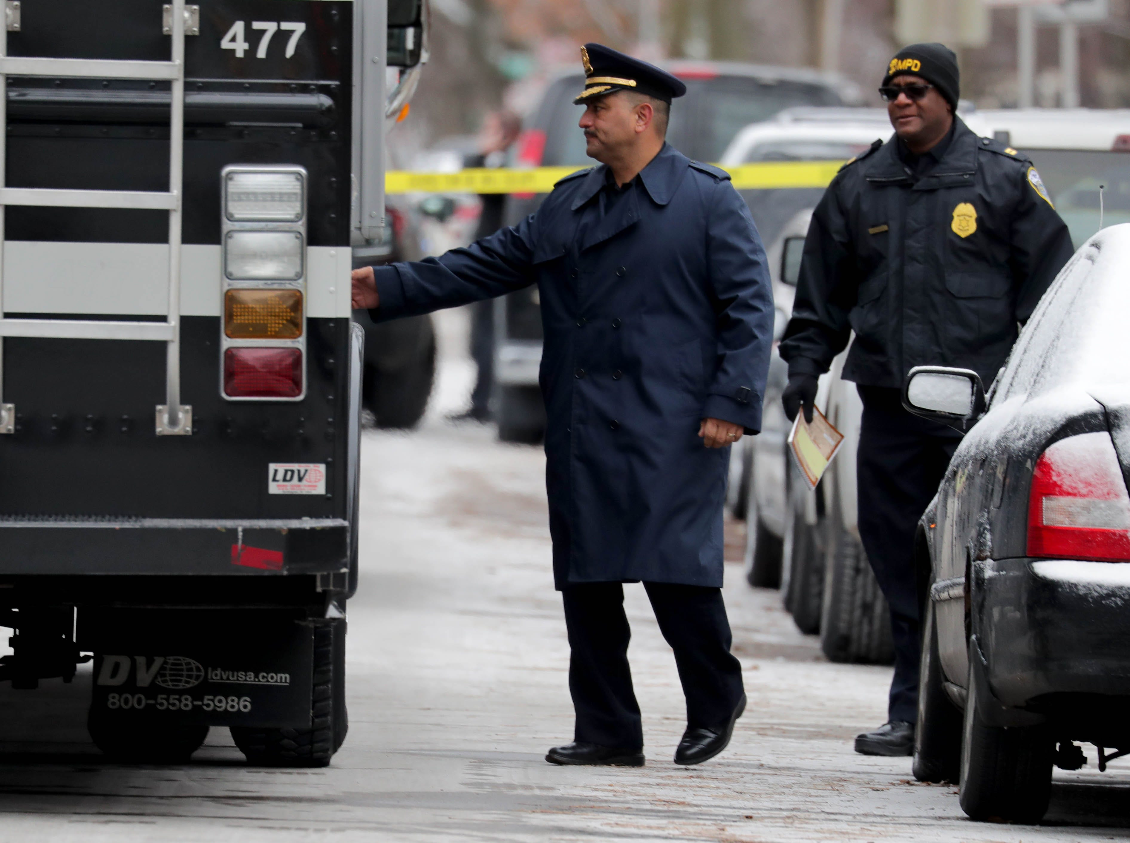 Milwaukee Police Chief Alfonso Morales enters an incident command post while on the scene.