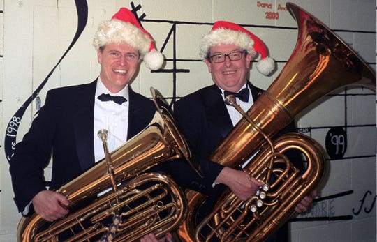 """Hanover Wind Symphony tuba players Phil Hughes of Whippany and Joe Melody of Randolph, prepare for the upcoming HWS """"Christmas Presence"""" concert on Sunday, Dec. 9, at Our Lady of Mercy R.C. Church in Whippany."""