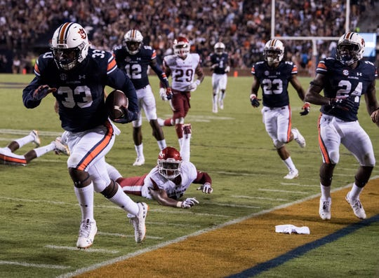 Auburn's K.J. Britt (33) returns a tipped punt against Arkansas at Jordan-Hare Stadium in Auburn, Ala., on Saturday, Sept. 21, 2018. Auburn defeated Arkansas 34-3.
