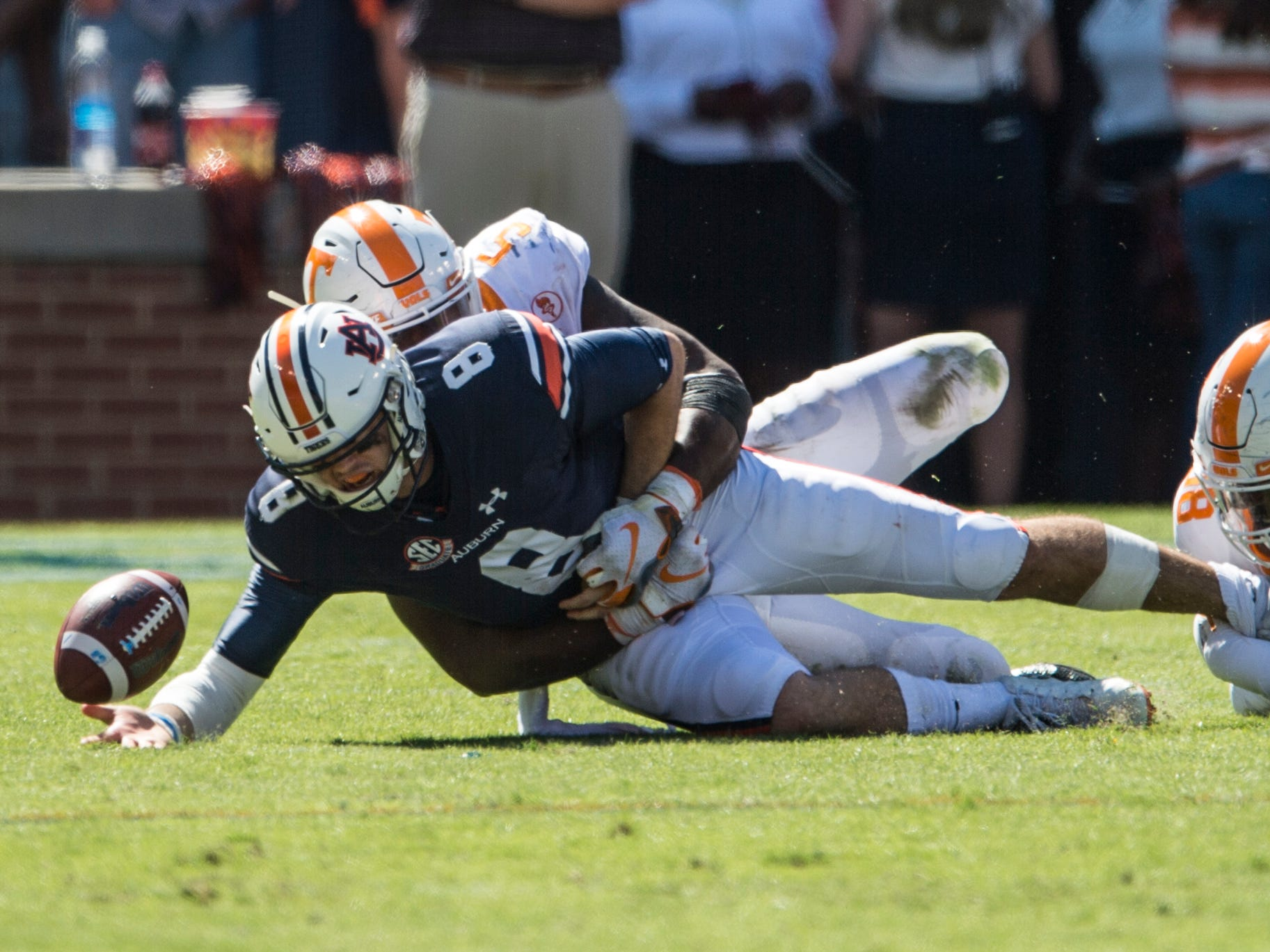 Auburn's Jarrett Stidham (8) looses the ball as he is taken down by Tennessee's Kyle Phillips (5) at Jordan-Hare Stadium in Auburn, Ala., on Saturday, Oct. 13, 2018. Tennessee defeated Auburn 30-24.
