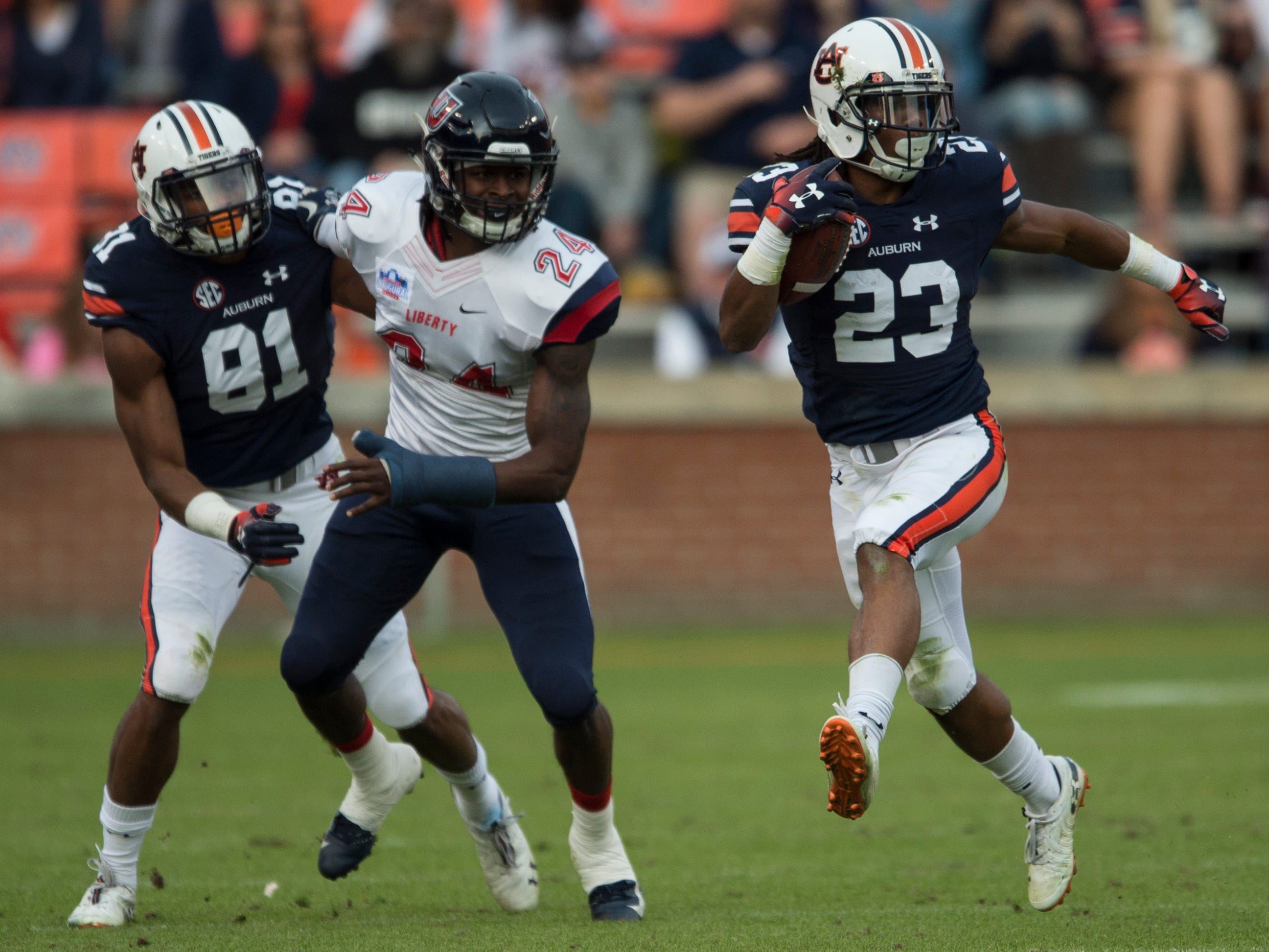 Auburn wide receiver Ryan Davis (23) runs the ball against Liberty at Jordan-Hare Stadium in Auburn, Ala., on Saturday, Nov.. 17, 2018. Auburn defeated Liberty 53-0.