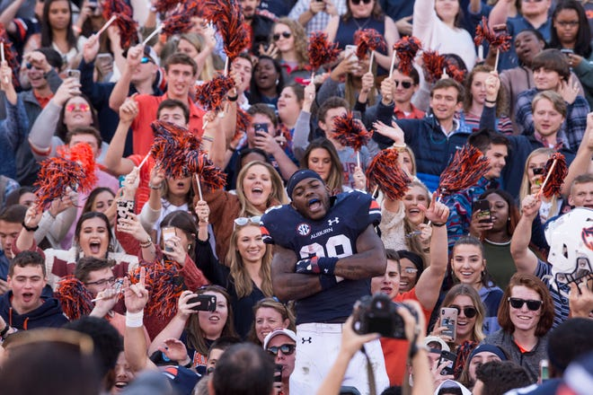 Auburn running back JaTarvious Whitlow (28) celebrates with fans after win over Texas A&M at Jordan-Hare Stadium on Saturday, Nov. 3, 2018.