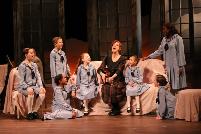 """Courtney Bassett stars as Maria Rainer, singing with the von Trapp children in Alabama Shakespeare Festival's production of """"The Sound of Music."""""""