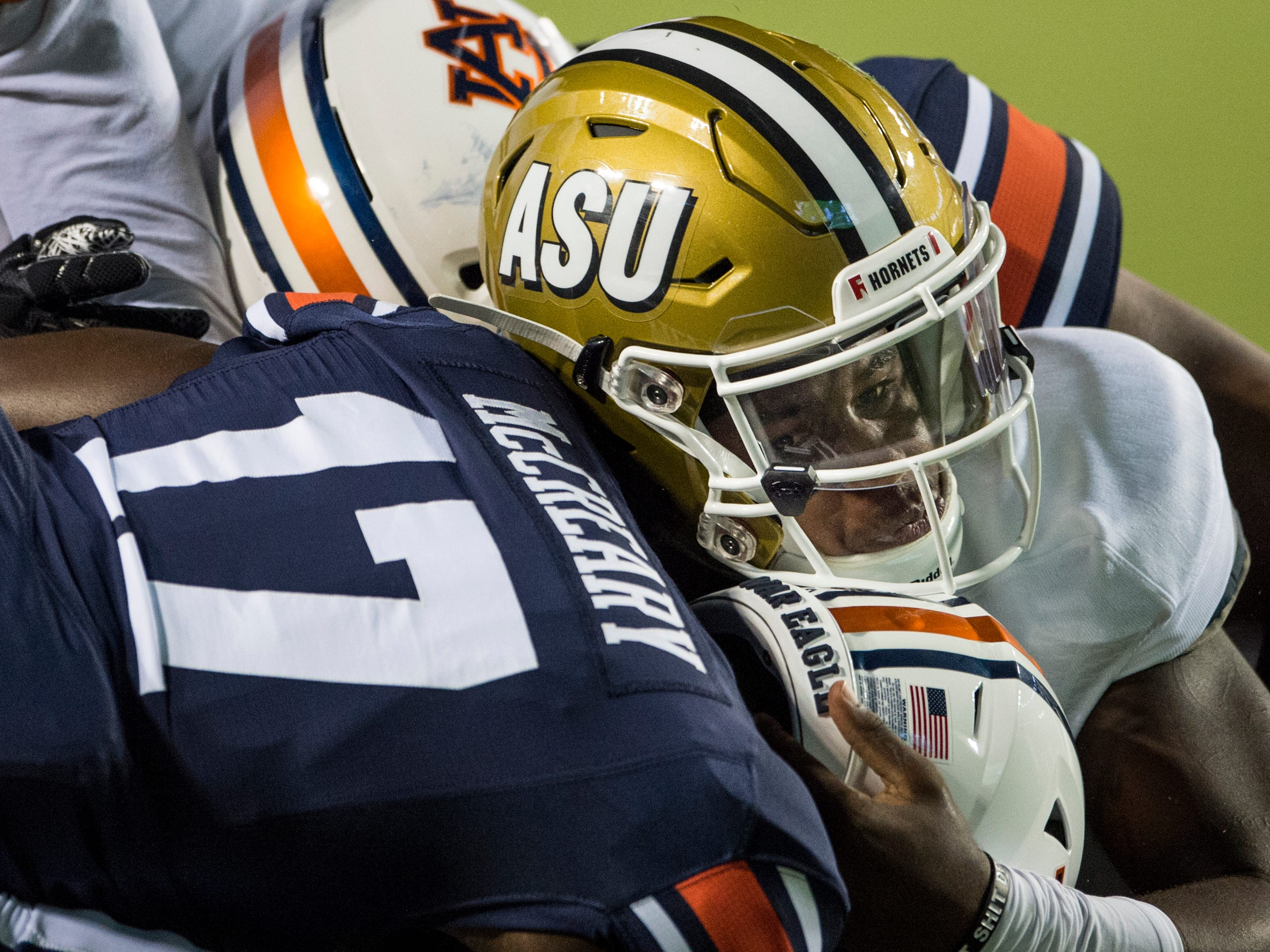 Alabama State's Palmer Graham (13) is sandwiched between Auburn's Roger McCreary (17) and Auburn's Tyrone Truesdell (94) at Jordan-Hare Stadium in Auburn, Ala., on Saturday, Sept. 8, 2018. Auburn defeated Alabama State 63-9.
