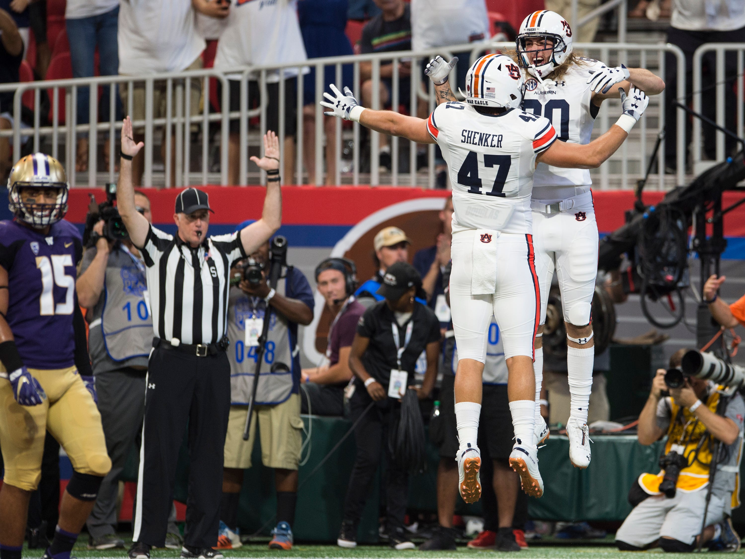 Auburn's John Samuel Shenker (47) and Auburn's Sal Cannella (80) celebrate Cannella's touchdown catch against Washington at Mercedes-Benz Stadium in Atlanta, Ga., on Saturday, Sept. 1, 2018. Auburn leads Washington 15-13 at halftime.