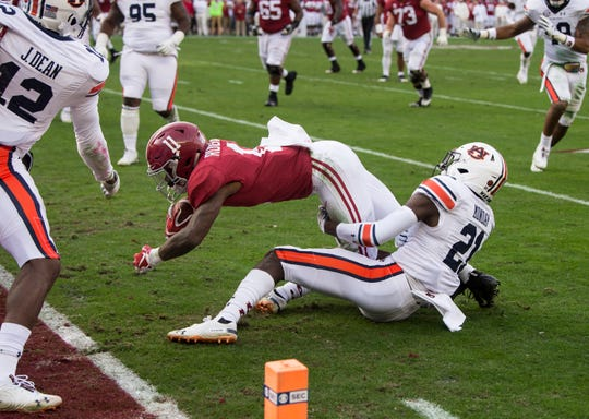 Alabama wide receiver Henry Ruggs, III, (11) dives for the goal line as he scores a touchdown during the Iron Bowl at Bryant-Denny Stadium in Tuscaloosa, Ala., on Saturday, Nov. 24, 2018. Alabama leads Auburn 17-14 at halftime.