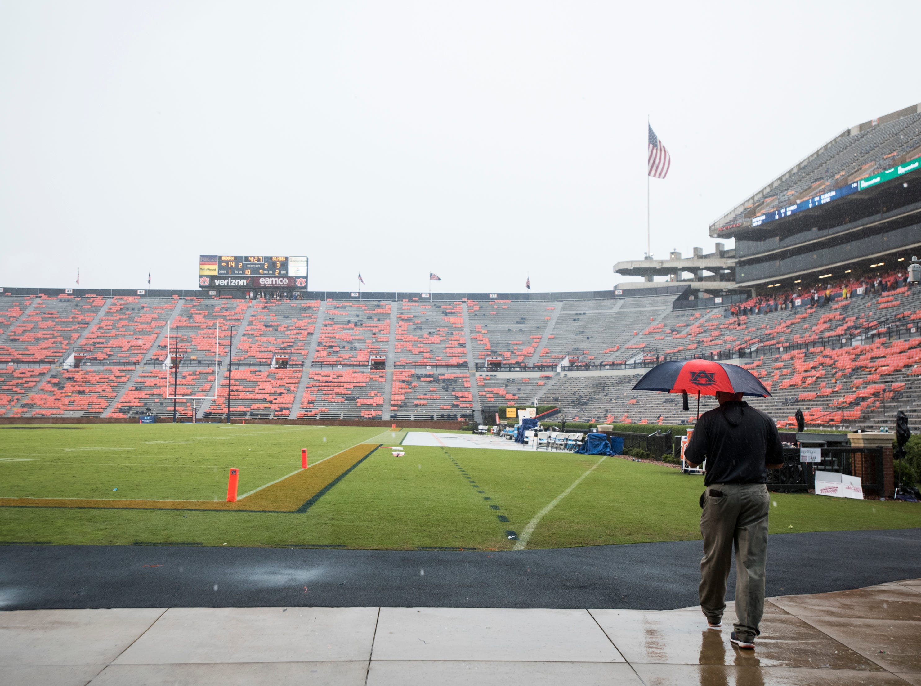 Players, fans, workers take cover during a weather delay at Jordan-Hare Stadium in Auburn, Ala., on Saturday, Sept. 29, 2018. Auburn leads Southern Miss 14-3, the game went into a weather delay with 4:27 left in the second quarter.