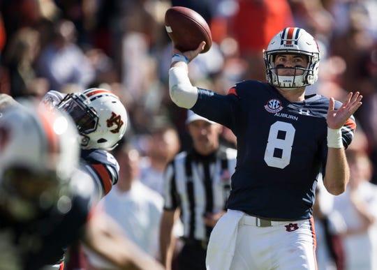 Auburn quarterback Jarrett Stidham (8) throws the game winning touchdown pass against Texas A&M at Jordan-Hare Stadium on Saturday, Nov. 3, 2018. Auburn defeated Texas A&M 28-24.