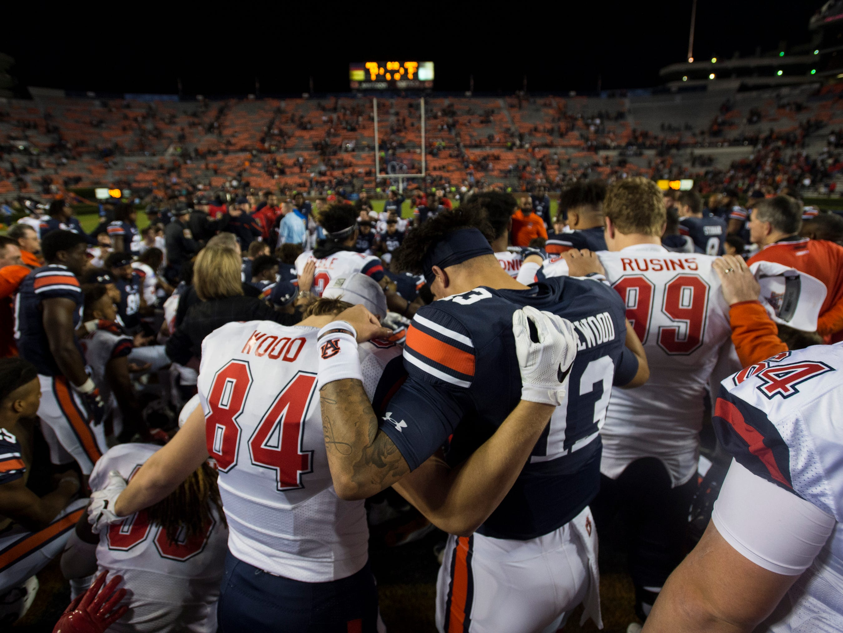 Auburn and Liberty players pray after the game at Jordan-Hare Stadium in Auburn, Ala., on Saturday, Nov.. 17, 2018. Auburn defeated Liberty 53-0.