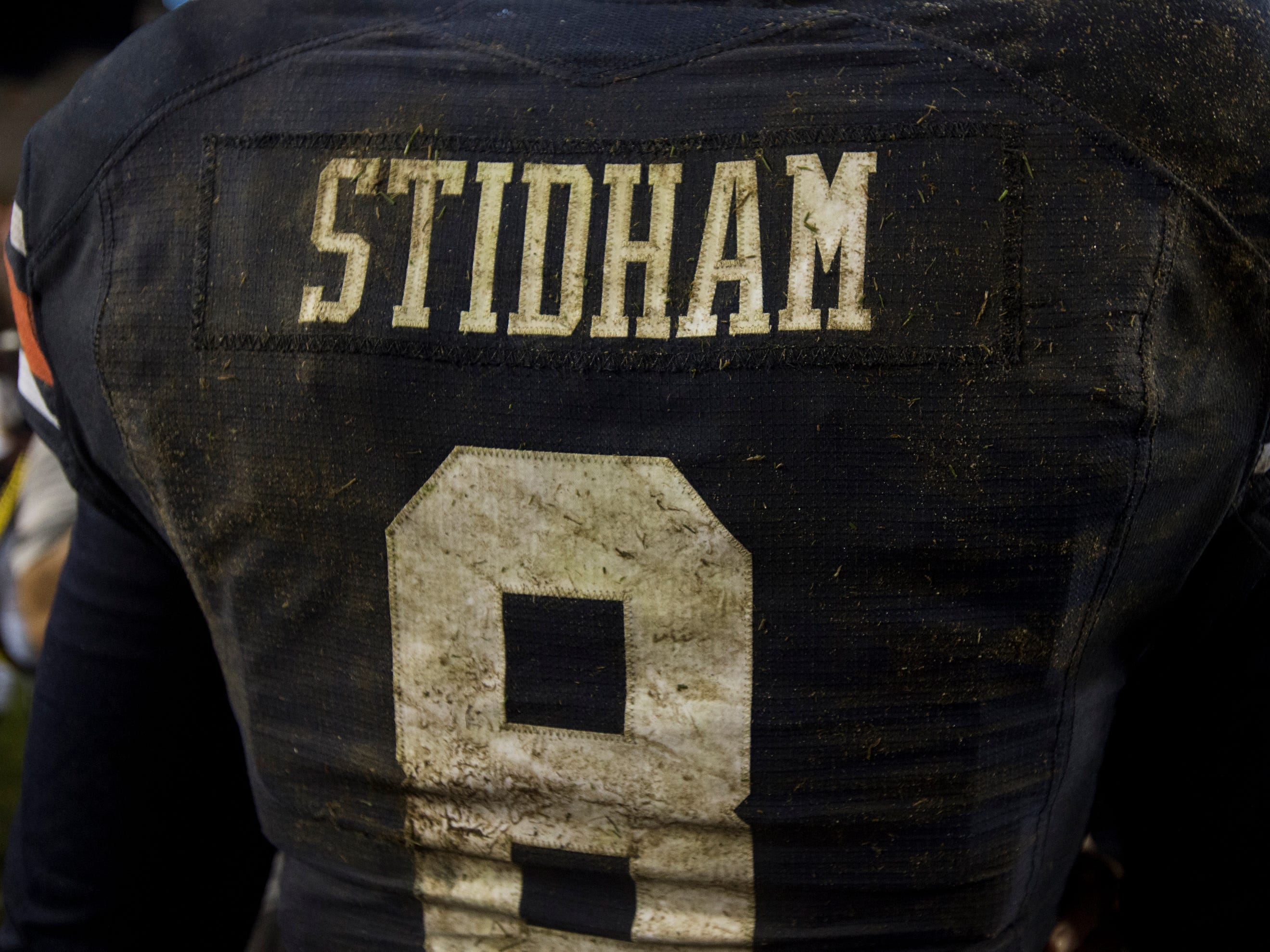 Auburn's Jarrett Stidham's (8) jersey is covered in mud after the game at Jordan-Hare Stadium in Auburn, Ala., on Saturday, Sept. 29, 2018. Auburn defeated  Southern Miss 24-13.