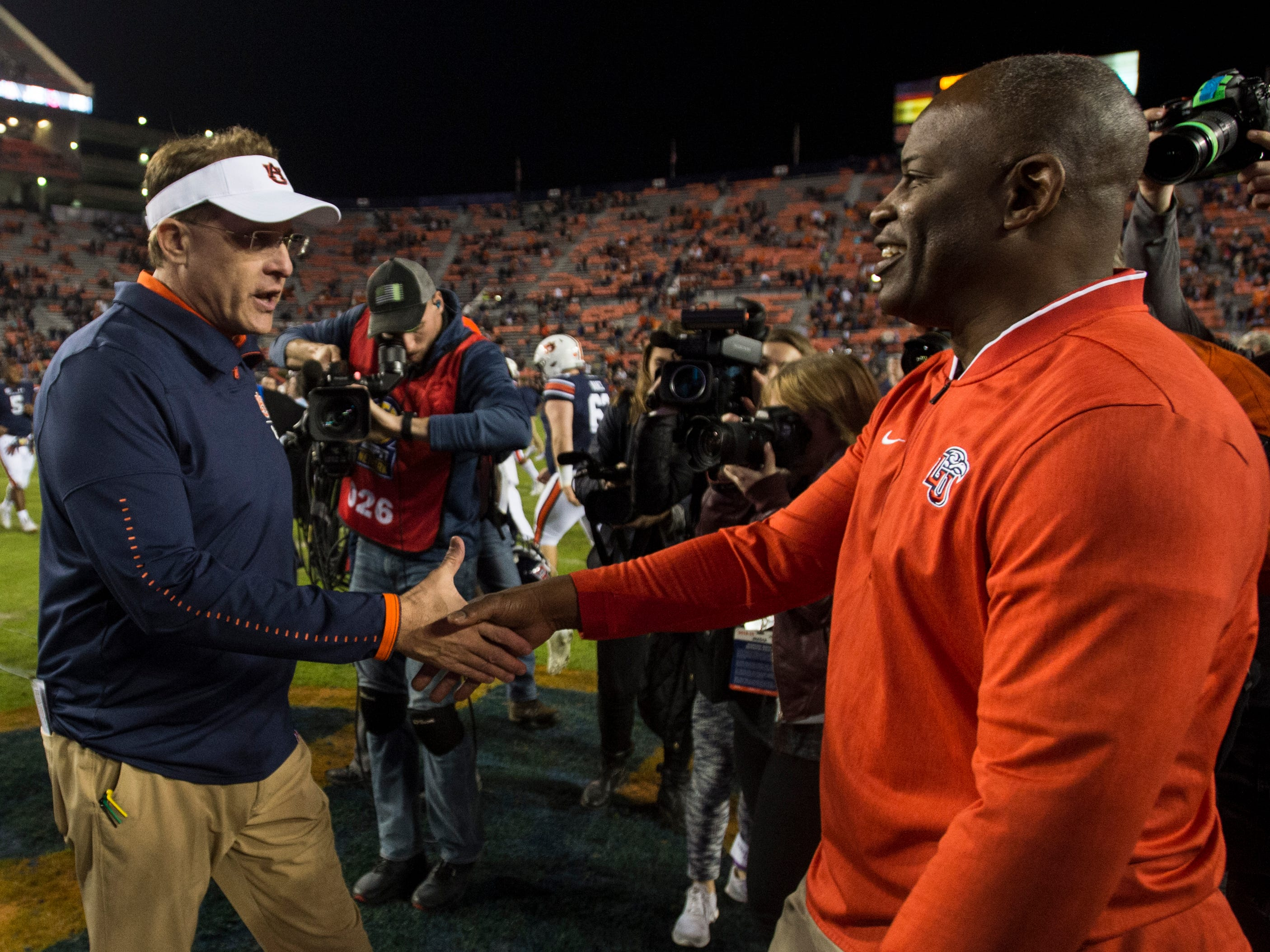 Auburn head coach Gus Malzahn shakes hands with Liberty head coach Turner Gill after the game at Jordan-Hare Stadium in Auburn, Ala., on Saturday, Nov.. 17, 2018. Auburn defeated Liberty 53-0.