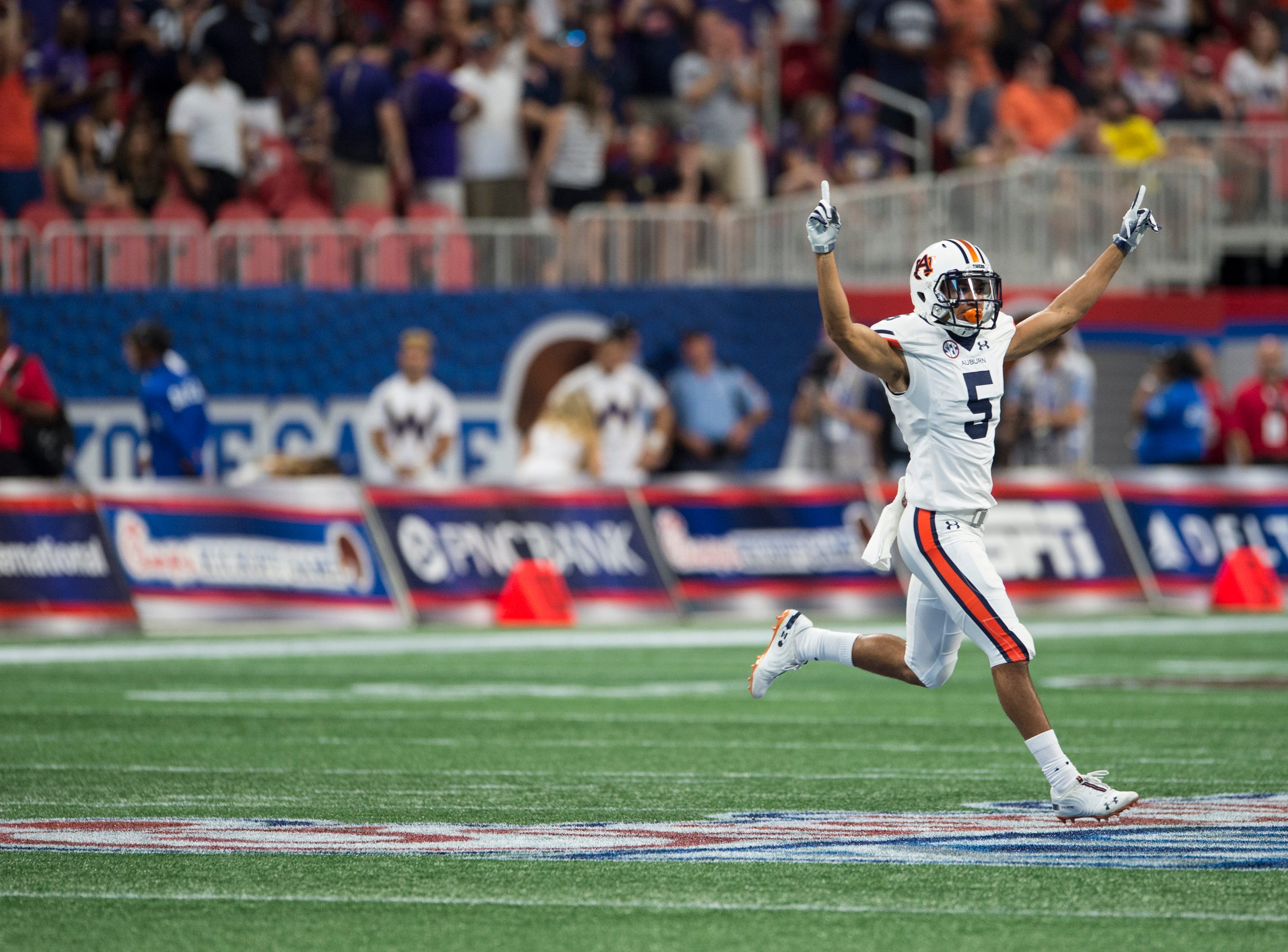 Auburn's Anthony Schwartz (5) celebrates as Auburn gets a game sealing first down at Mercedes-Benz Stadium in Atlanta, Ga., on Saturday, Sept. 1, 2018. Auburn defeated Washington 21-16 in the Chick-fil-a Kickoff Game.