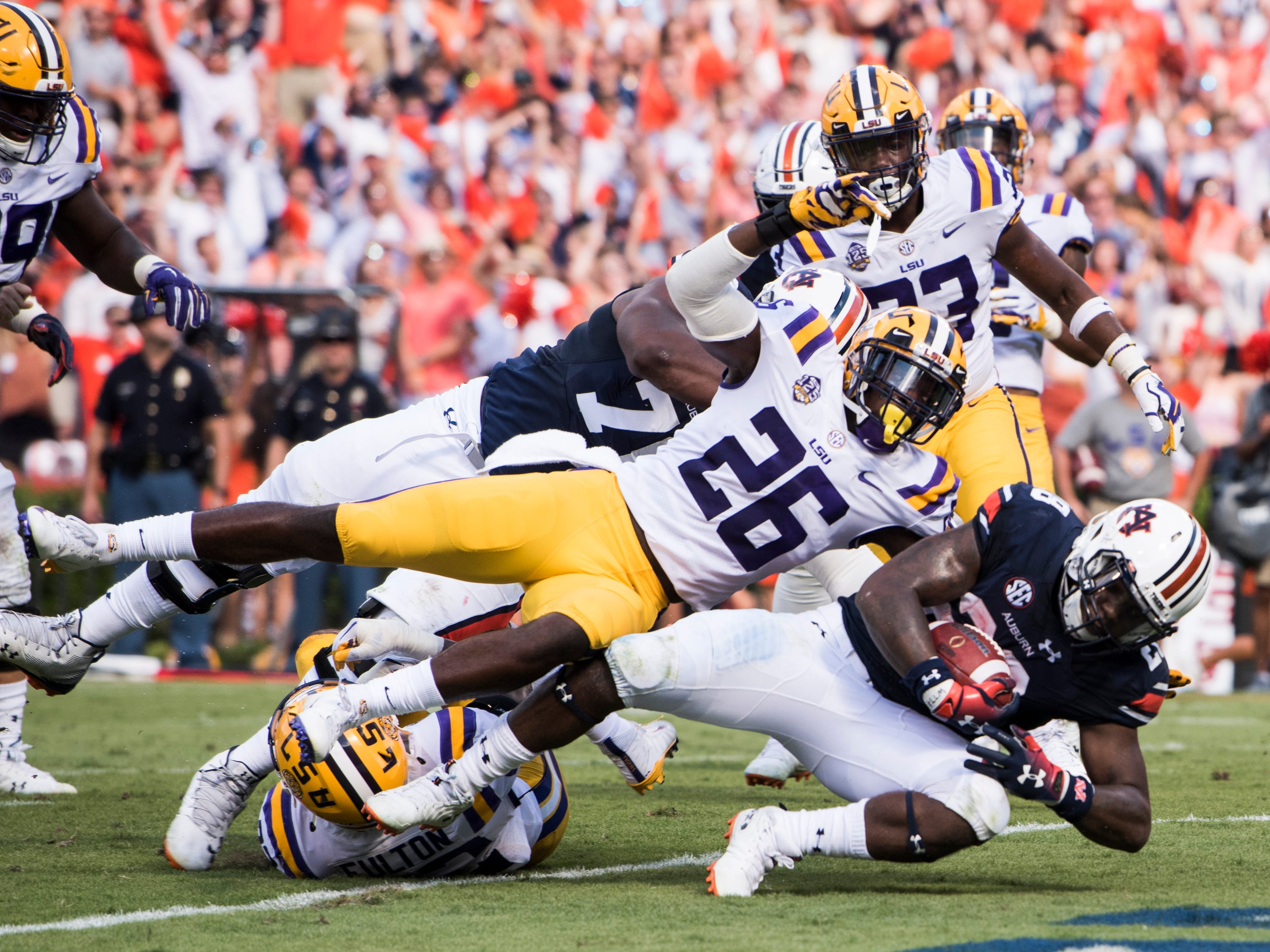 Auburn's JaTarvious Whitlow (28) falls into the end zone for a touchdown against LSU at Jordan-Hare Stadium in Auburn, Ala., on Saturday, Sept. 15, 2018. Auburn leads LSU 14-10 at halftime.