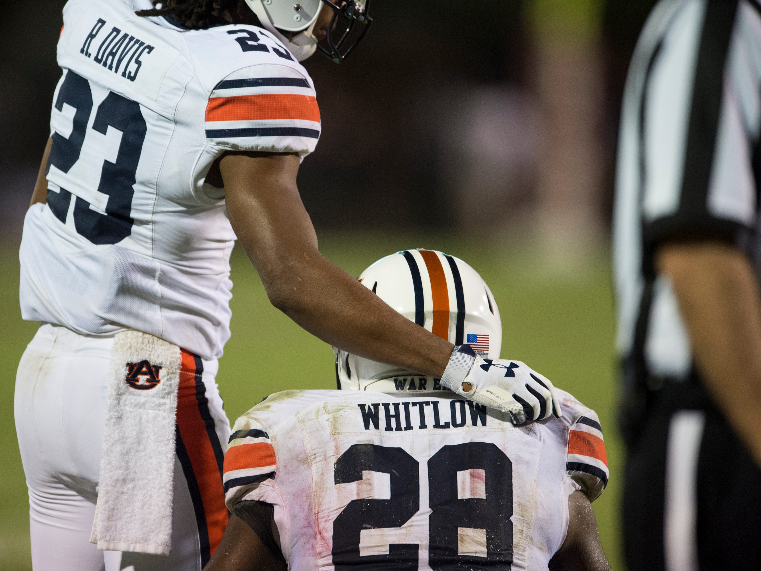 Auburn's Ryan Davis (23) comforts JaTarvious Whitlow (28) after Whitlow's fumble on the goal line at Davis Wade Stadium in Starkville, Miss., on Saturday, Oct. 6, 2018. Mississippi State defeated Auburn 23-9.