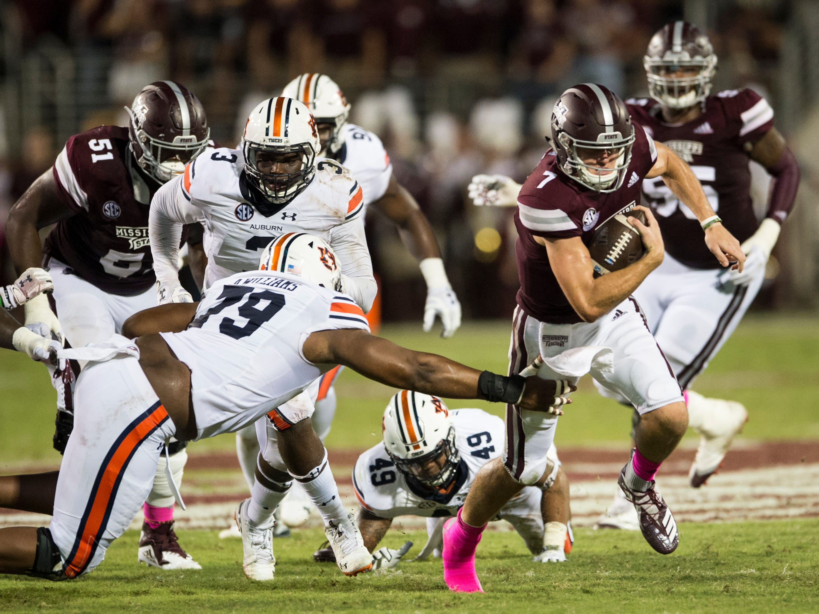 Mississippi State's Nick Fitzgerald (7) runs the ball against  Auburn at Davis Wade Stadium in Starkville, Miss., on Saturday, Oct. 6, 2018. Mississippi State leads Auburn 13-3 at halftime.