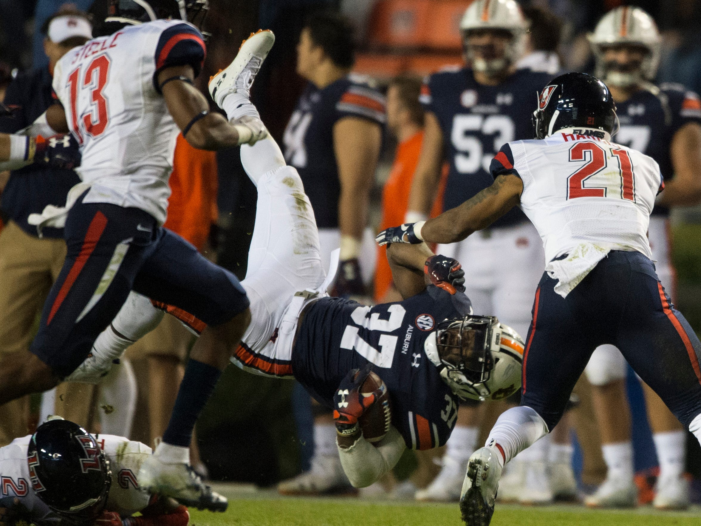 Auburn runing back C.J. Tolbert (37) is flipped upside down as he runs the ball against Liberty at Jordan-Hare Stadium in Auburn, Ala., on Saturday, Nov.. 17, 2018. Auburn defeated Liberty 53-0.