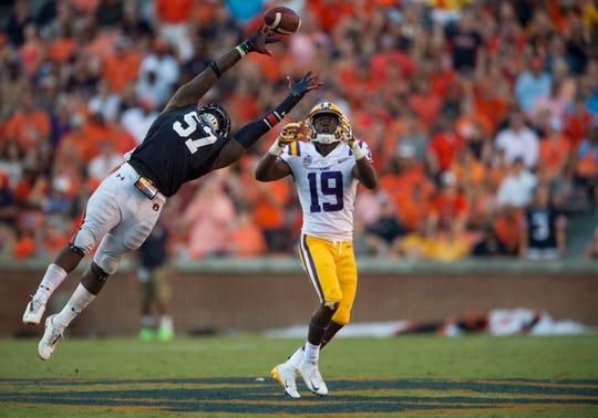 LSU's Derrick Dillon (19) catches the ball over Auburn's Deshaun Davis (57) and runs it in for a  touchdown at Jordan-Hare Stadium in Auburn, Ala., on Saturday, Sept. 15, 2018. LSU defeated Auburn 22-21.