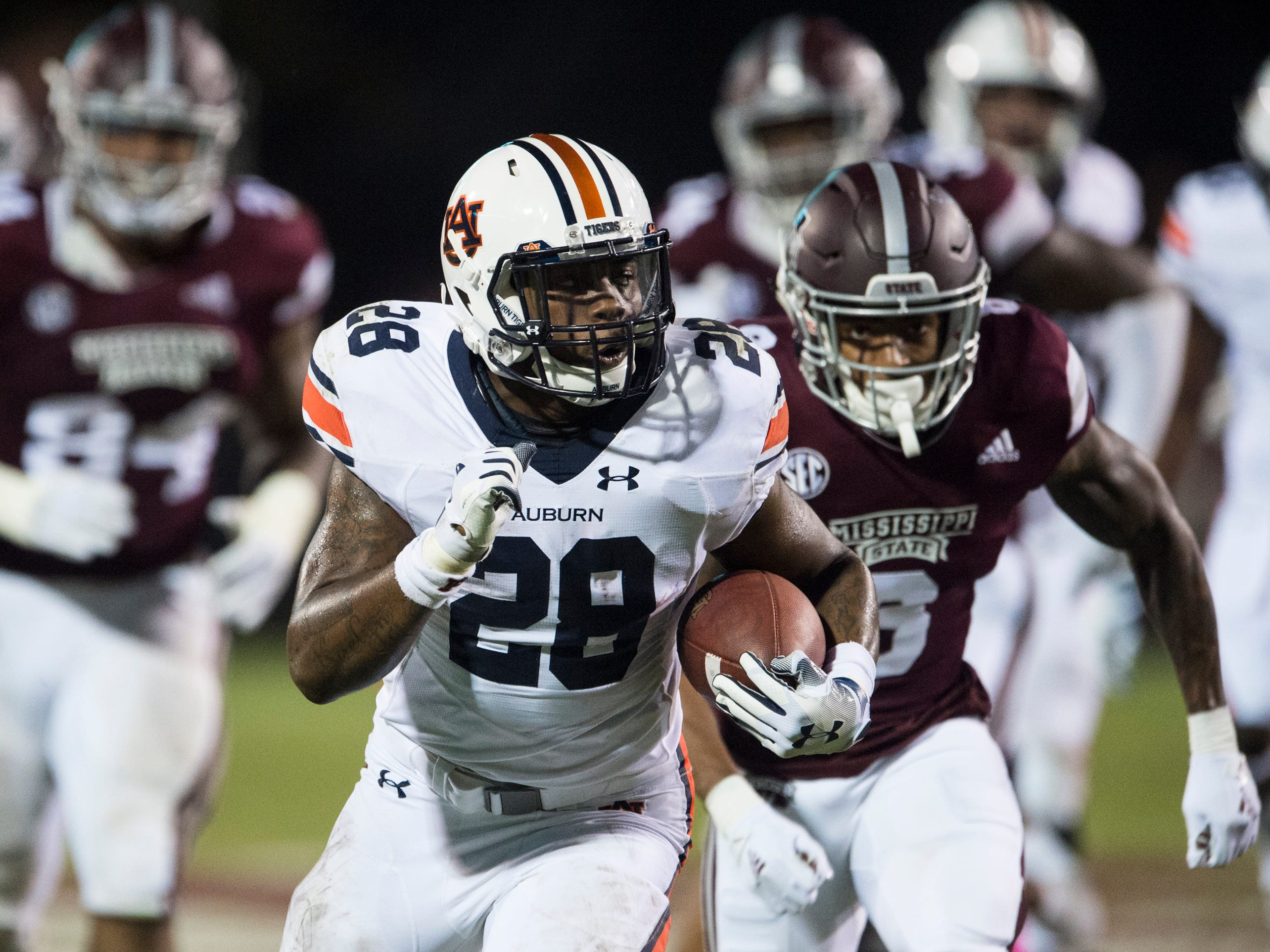Auburn's JaTarvious Whitlow (28) breaks a run eventually fumbling the ball as he dives into the end zone at Davis Wade Stadium in Starkville, Miss., on Saturday, Oct. 6, 2018. Mississippi State defeated Auburn 23-9.